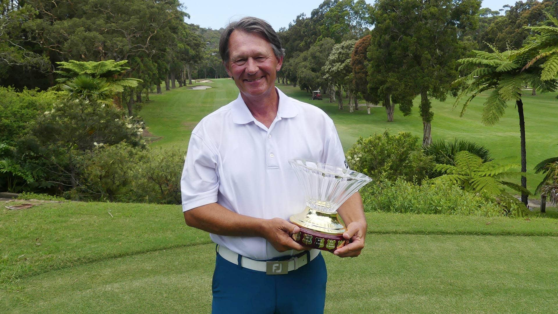 Ken Brewer with the Golf NSW Senior Order of Merit Trophy