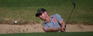 Chris Campbell blasts from a bunker on the first hole in the NSW Mid Amateur Championship at Shoalhaven Heads Golf Club
