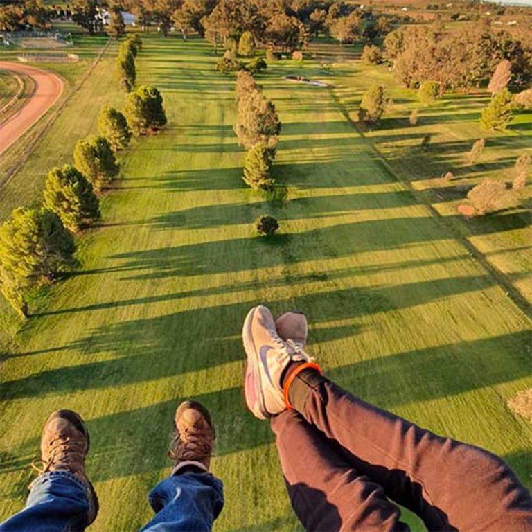 view looking down form hot air ballon at Hot Air Balloon lands at Canowindra Golf Club