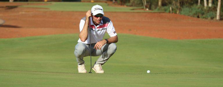 Jordan Zuni lines up a putt