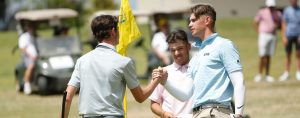 Josh Armstrong and Nathan Barbieri congratulate Elvis Smylie