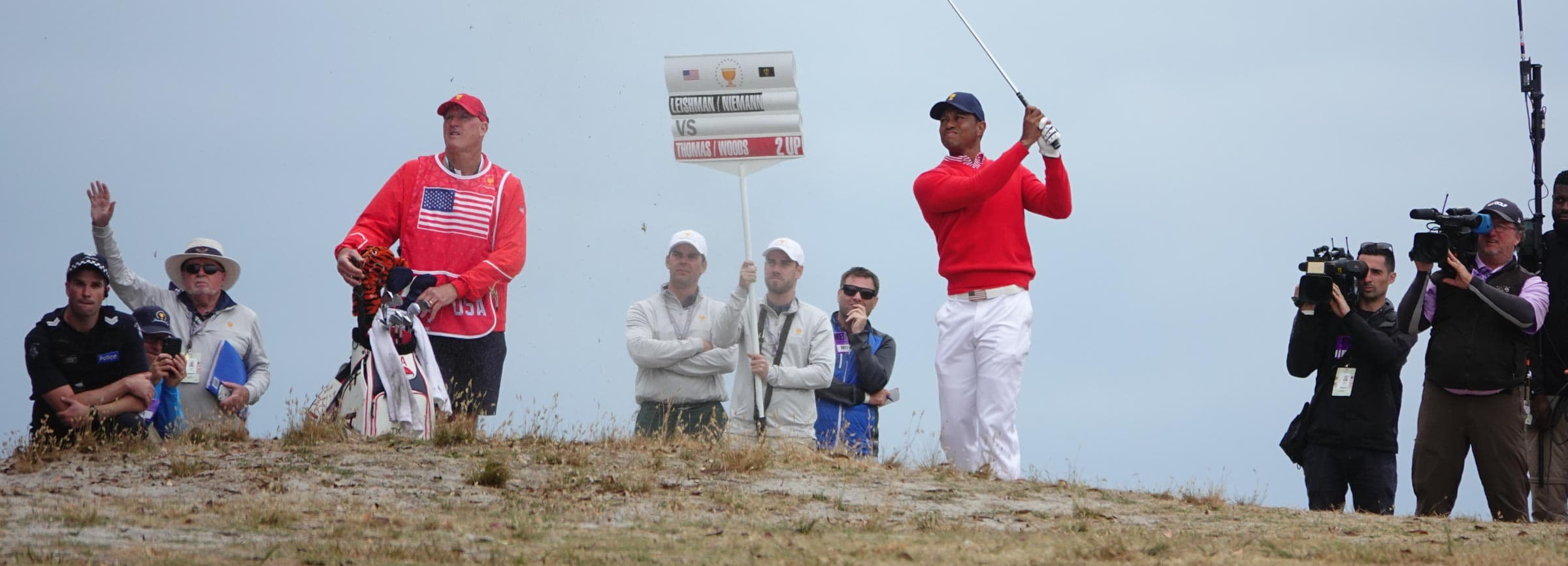 Tiger woods watches the result of this approach on the 11th hole ion the opening matches of the 2019 Presidents Cup.