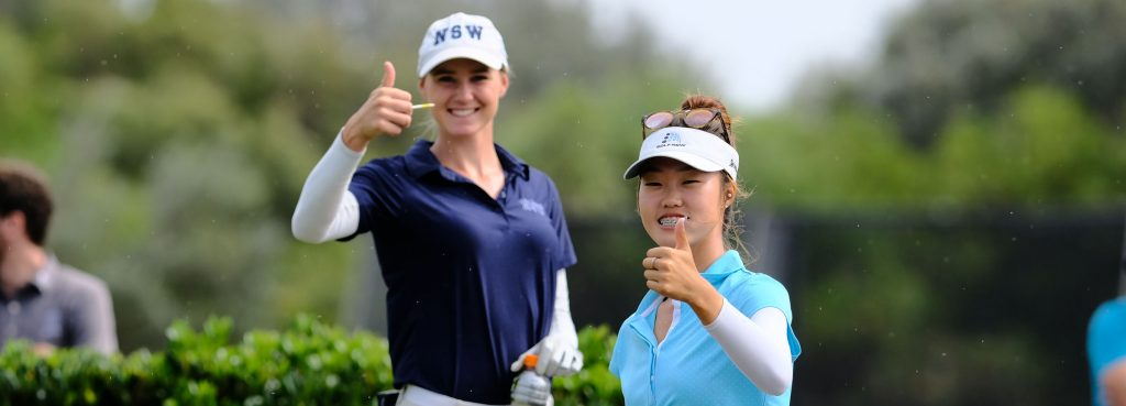 Kelsey Bennett and Grace Kim are all smiles mid round of the womens final