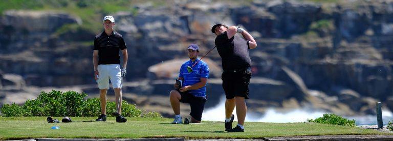 Corey Lamb hits a drive at the Coast Golf Club