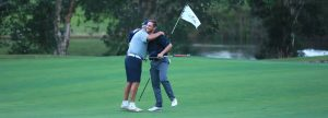 Player and Caddy embrace