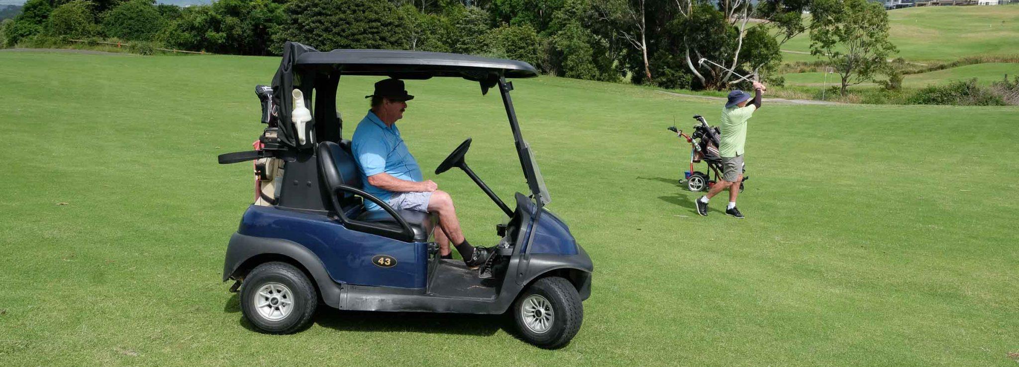 Golfer in a Cart