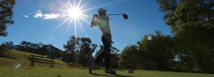 Image of a golfer in silhouette