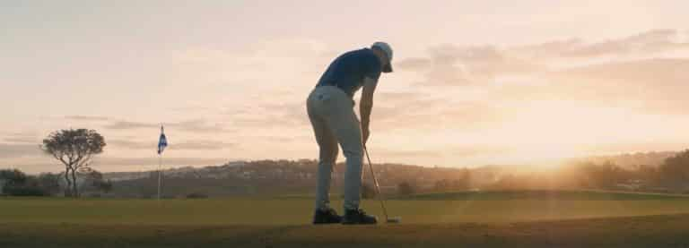 Golfer putting at Sunset