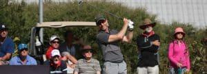 Golfer hitting a tee shot
