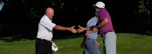 Peter Kirwin shakes hands post round