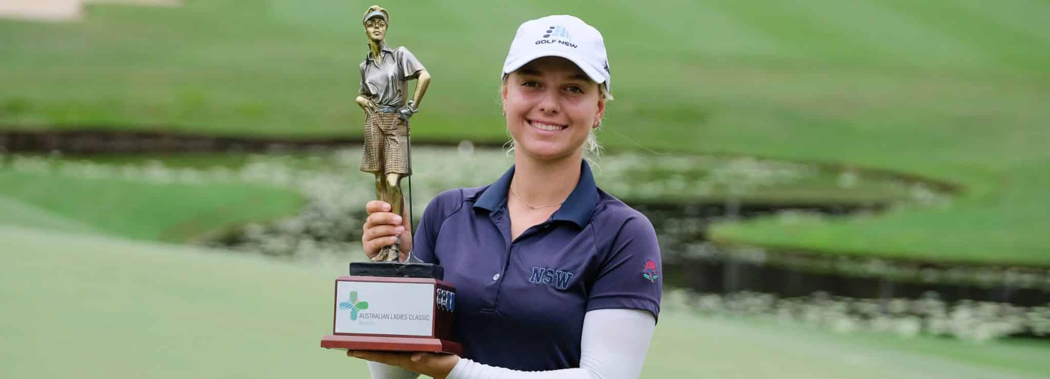 Stephanie Kyriacou holding the Australian Ladies Classic trophy