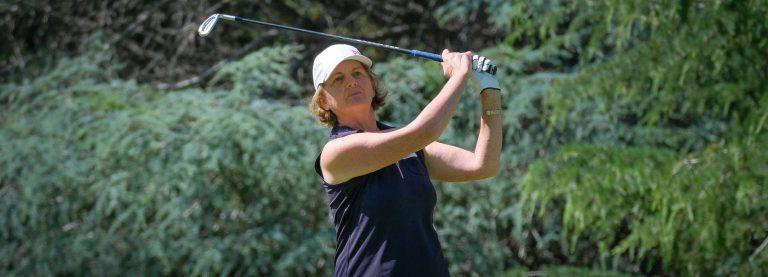 Louise Mullard watches a golf shot