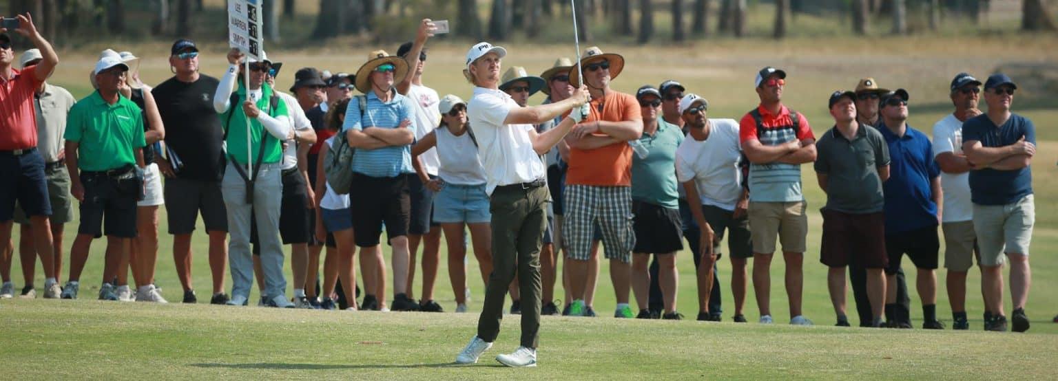 memberships rising - fans watch a golfer
