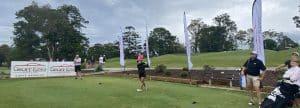 golfer hits a tee shot