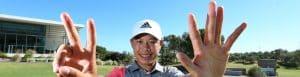 golfer holds up 7 fingers