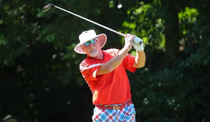 golfer watches shot