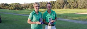 golfers holding trophies