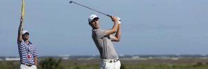 Golfer watches a tee shot