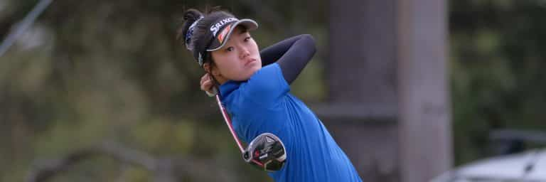 Female Golfer looks on after a shot