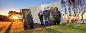 lady golfers present a cheque to Lifeline officials